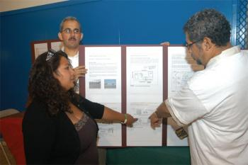 Kinder garden still in the air: Mauricio Vela (right) shows Alejandra Lara, mother of a kinder garden student, the plan for the new kinder garden plan, while architect Armando Vázquez observes. ( PHOTO BY MARVIN J. RAMIREZ )
