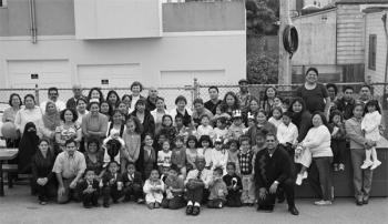 Mauricio Vela (at front in black), with Kinder Garden students,: teachers and parents af ter a class graduation Bernal Preschool.