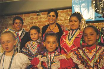 A struggle without giving in: Mexican human rights activista Lydia Cacho Ribeiro takes a moment with the children of Mexican Ballet Folklórico Infantil at the Women's Building in San Francisco after being honored by Amnesty International.