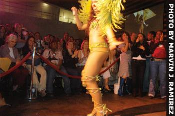 A Queen of Carnival contestant dances in front of the audience at the Fanatics Sports Entertainment Complex on March 31.