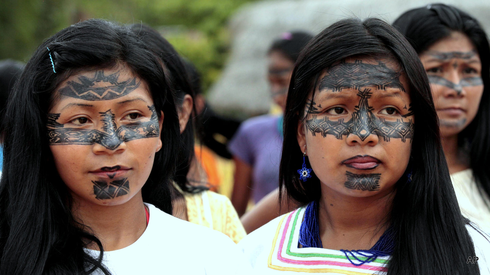 Sarayaku women attend a ceremony where the Ecuadorian Government offered a public apology to the Sarayaku community in Sarayaku, Ecuador, Wednesday, Oct. 1, 2014. The apology from the Ecuadorian state came as part of a ruling by the Inter-American Human Rights Court which found that the government allowed for oil exploration in Sarayaku lands without their consent. (AP Photos/Dolores Ochoa)