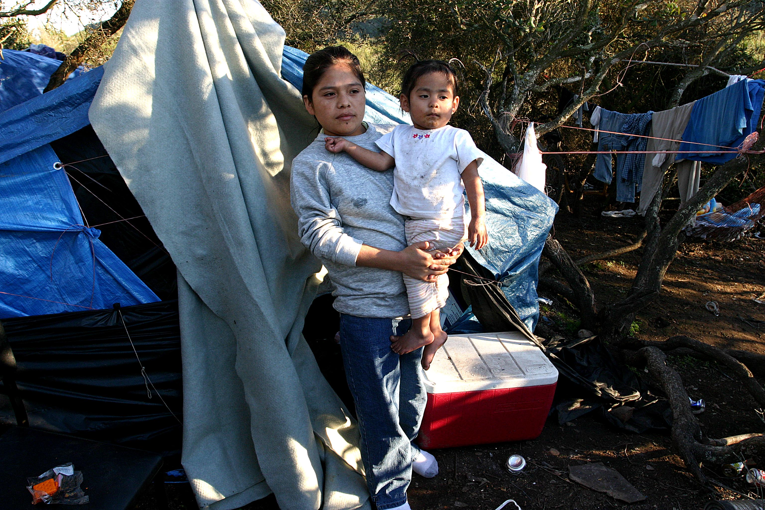dnbsandiego25.jpg  SAN DIEGO, CA - 1FEBRUARY05 - Indigenous Mixtec and Zapotec farm workers from Oaxaca, living in a camp on a hillside outside Delmar.  Copyright David Bacon